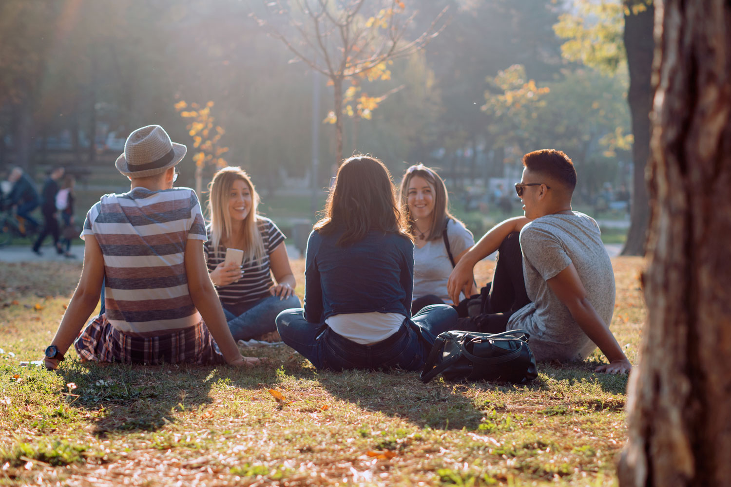 young people hanging out in the park
